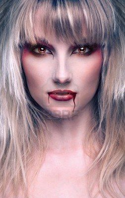 Beautiful Vampire with Bloody Streaks.. Halloween make-up inspiration!