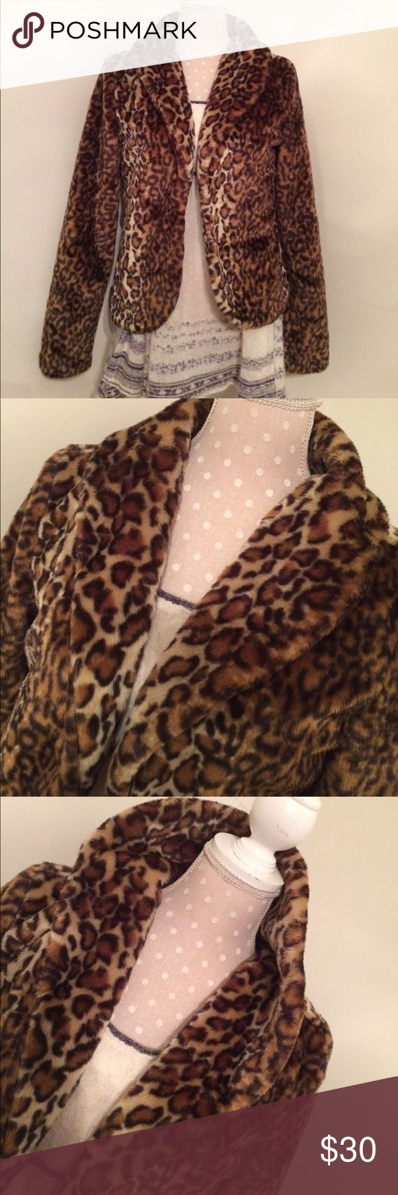"Tulle animal print faux fur jacket Adorable piece is just right to wear over a strappy dress  for a sexy night out! Shell and exterior are both 100% polyester. Measures  22"" down from the seam of the collar to very bottom hem. Arm length is 24"".. This item os flawless. Comes from a non smoking seller. 20% off discount applies to 3 or more items! Thank you for looking.💗 Tulle Jackets & Coats"