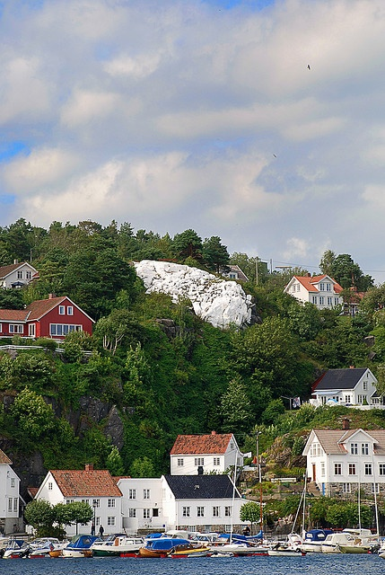 Risør, Norway. Spent a couple of summer holidays there. No water in the cabin, and there was an outdoor toilet. Yuk. We went fishing every day, and ate fresh fish at every meal. Even breakfast. Very healthy.