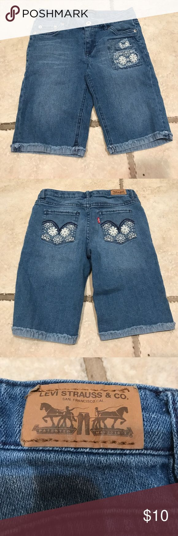 Girls Levi Bermuda shorts Girls Levi Bermuda shorts. Lighter wash, lace designs on back pockets and on the front, adjustable waistband, good condition, size 12 reg Levi's Bottoms Shorts