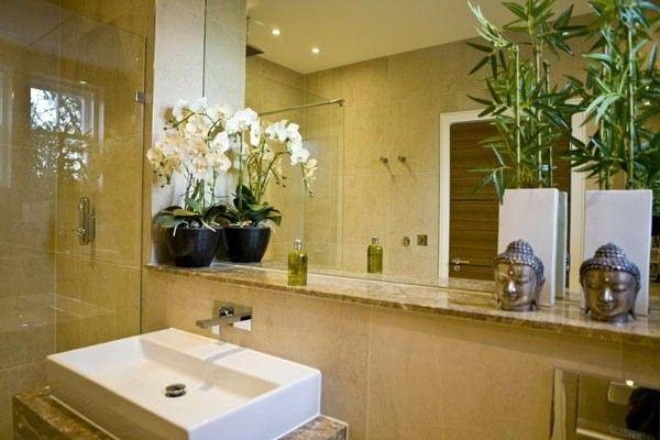 cozy bathroom with a big mirror