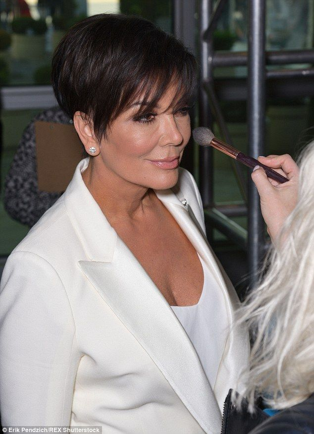 Behind the scenes: Kris received a little touch-up before she made her way onto the carpet...