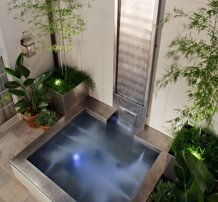 "Hybrid Spa/Cold Plunge Pool with Stainless Steel Water Feature Spa dimensions: 98.5"" x 103"" x 36"" Water Feature Dimensions: 24"" x 180"""