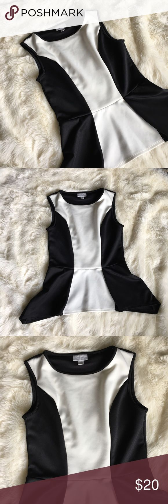 """Bisou Bisou Black & White Peplum Top Black and white peplum top. Excellent condition. No signs of wear.  Made from sanded so it has stretch to it. Perfect for dressing up or down.  Length approx 23.5"""" Chest approx 16"""" Waist approx 14.5"""" Bisou Bisou Tops Tank Tops"""