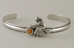 An Adorable Little Witch on a Sterling Silver Cuff Bracelet Accented with Genuine Amber Silver Dragon-Bracelets. $50.00