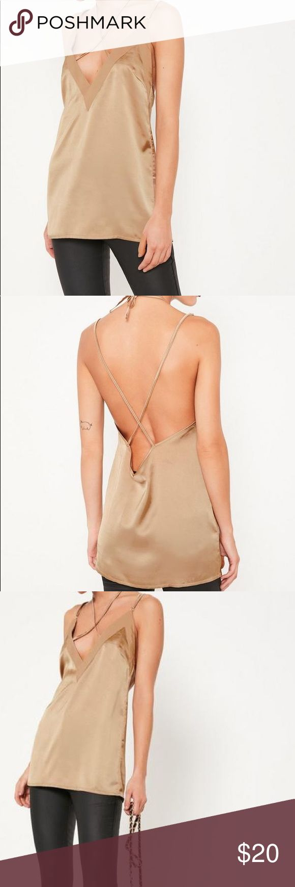 Nude Cami Top Misguided Nude Cami top. Cross neckline ties around your neck, cross cross low cut back. Size womens US 4. Missguided Tops Blouses
