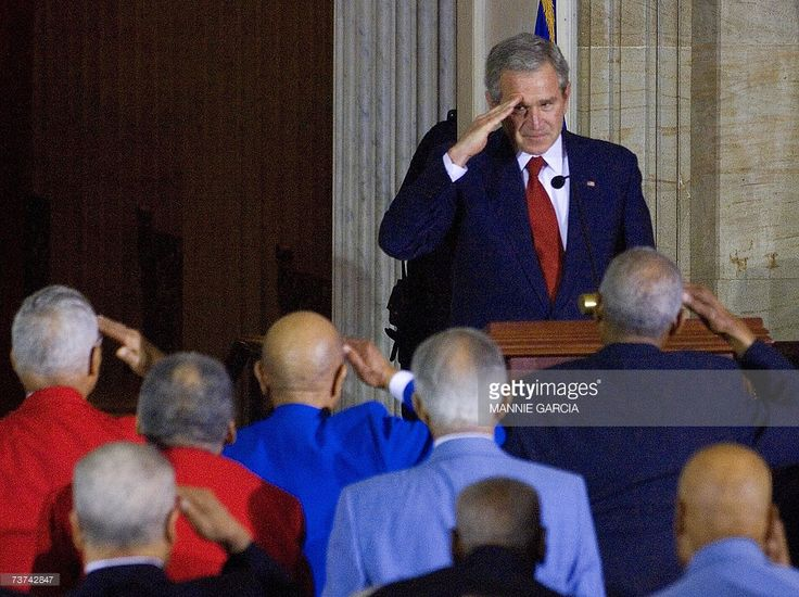 US President George W. Bush salutes the legendary Tuskegee Airmen during a ceremony in which they were recognized with a Congressional Gold Medal in the Rotunda of the Capitol Building in Washington, DC, 29 March 2007. The United States Thursday honored the Tuskegee Airmen, some 300 black pilots who made their proud mark flying fighters over Europe in World War II, six decades after the war's end. The group was presented the Congressional Gold Medal, Congress's foremost award for civilians…