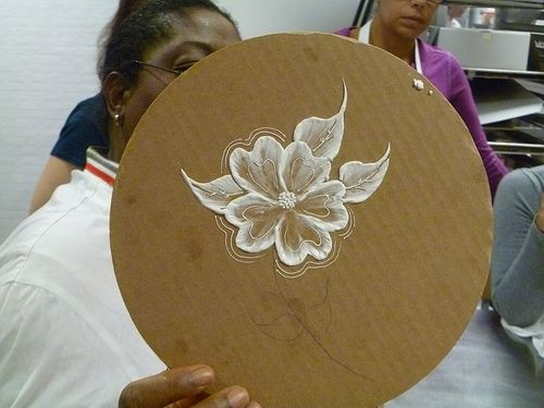 Toba demonstrating brush embroidery.  Learn How to Decorate Cakes - Visit Online ABC Cake Decorating Classes on http://CakeDecoratingCoursesOnline.com