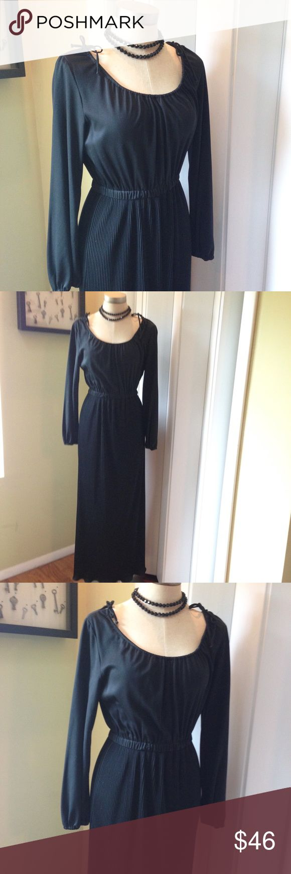 Black Vintage Accordion Gown Beautiful slimming vintage black polyester accordion gown. Labeled a 12, best fit 8/10. In great condition. Elastic waist. Side shoulder ties to adjust bust/ overall front look. Necklace not included but for sale in my closet. Vintage Dresses Maxi