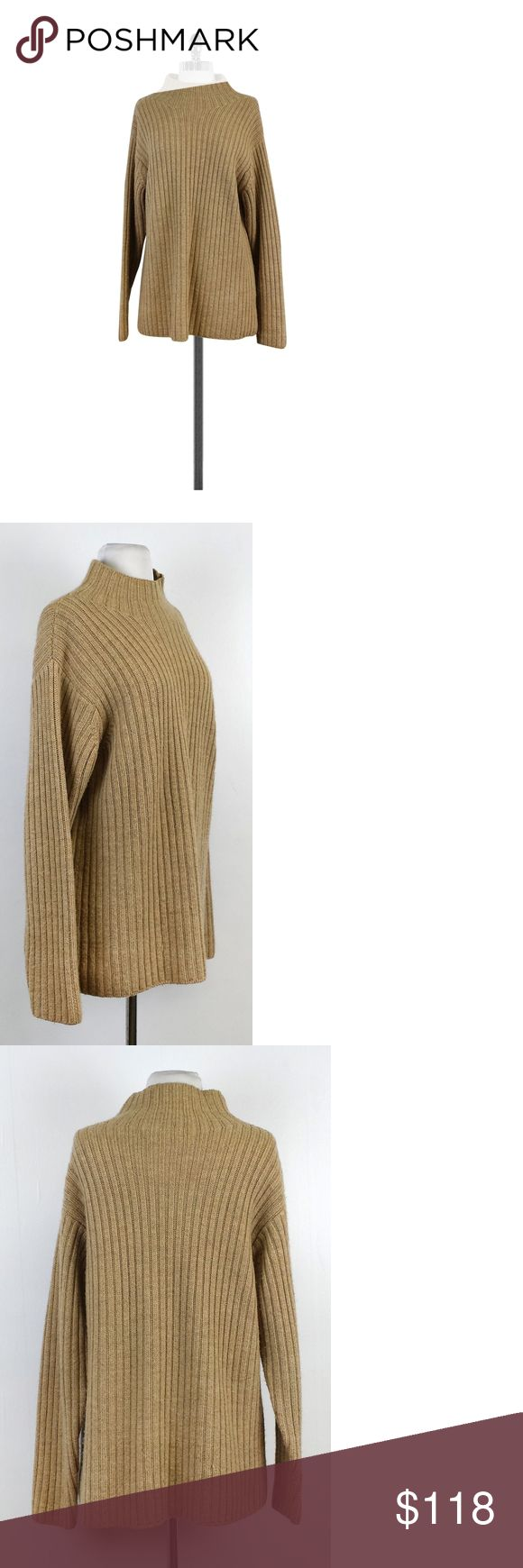 "Burberry- Tan Ribbed Wool Mockneck Sweater Sz L Add this effortless tan ribbed sweater to your favorite jeans and thigh high boots and be instantly casual chic. Made of wool, this classic sweater will keep you cozy and stylish. Size Large 100% wool Made in USA Pull over Mock neck Long sleeves Ribbed Loose fit Fabric pilling Shoulder to hem 27"" Known for their signature tartan pattern, Burberry is a British luxury brand that offers clothing, accessories and fragrances. This brand can be…"