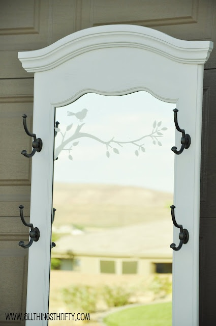 Add hooks to my similar mirror.  I like the added embellishment on the mirror with etched vinyl, as well.