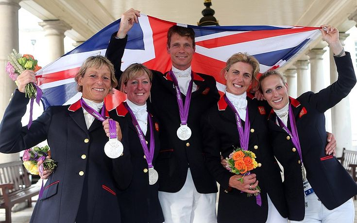 Mary King, Nicola Wilson, William Fox-Pitt, Tina Cook and Zara Phillips celebrate with their Silver medals after finishing second in the Team Eventing