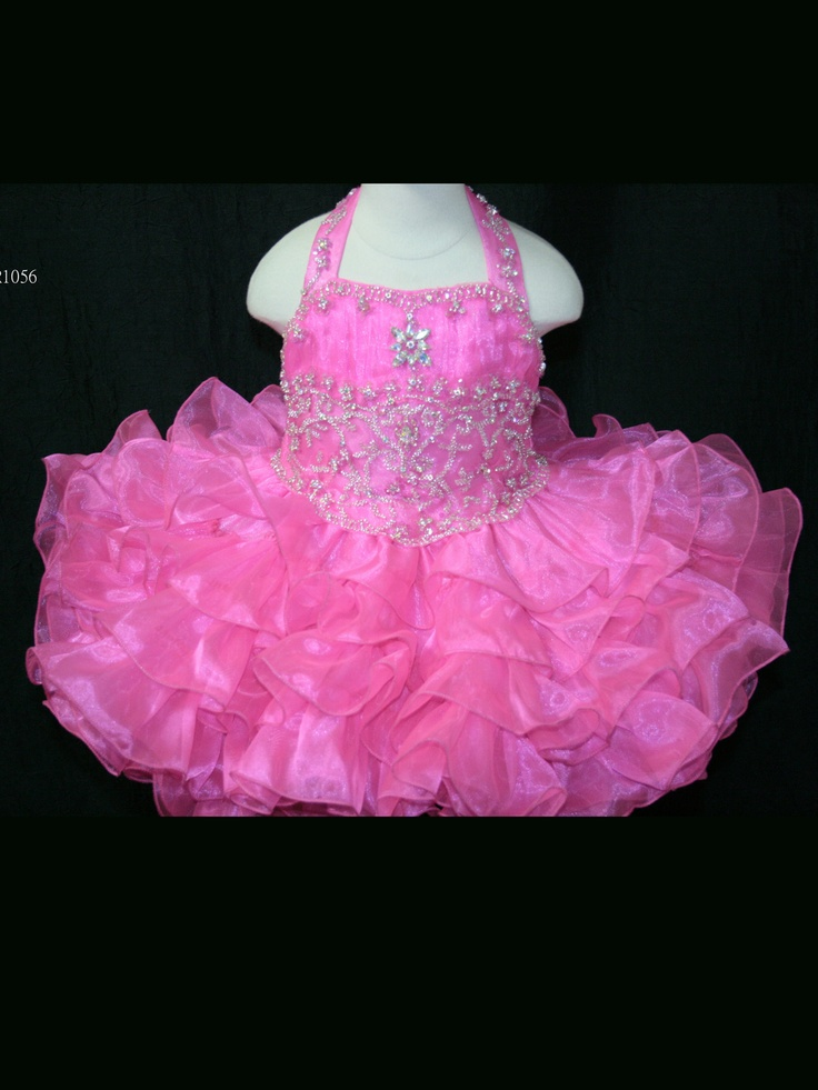 Adorable Little Rosie Babies Pageant Dress BR1056. This organza pageant dress has a beaded halter neckline, ruched and embroidered bust, and basque waistline. Completing the look of this pageant dress is a tiered short skirt. Make this cute dress perfect for your next pageant.