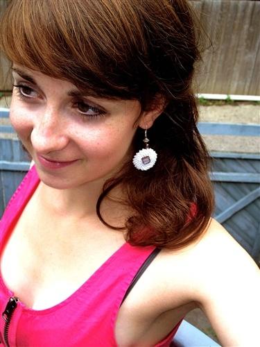jess wearing white earrings