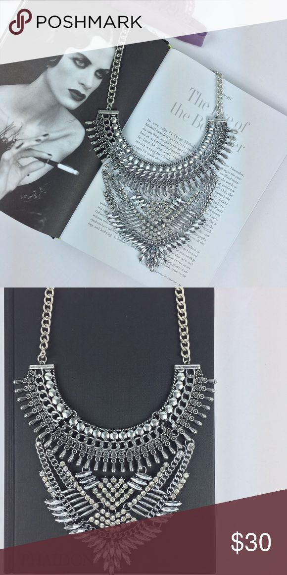 Statement Silver Rhinestone Necklace Gorgeous silver Rhinestone statement necklace! Versatile necklace that gives any outfit an extra trendy look. Add a statement necklace for an added boldness that will elevate your style. Adjustable clasp and chain. The rhinestones are clear. The metal detail is silver. Never worn. New. No trades please. Jewelry Necklaces