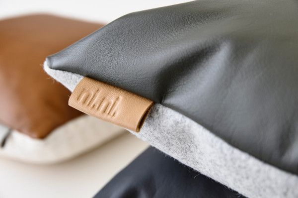 Devil is in the details. Our leather tab cushion showing off both sides; a combo of 100% wool felt and leather www.ninicreative.com