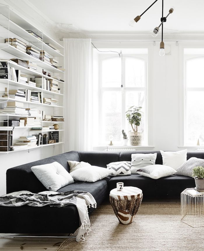 contemporary #living_room with black sofa and #natural_textures