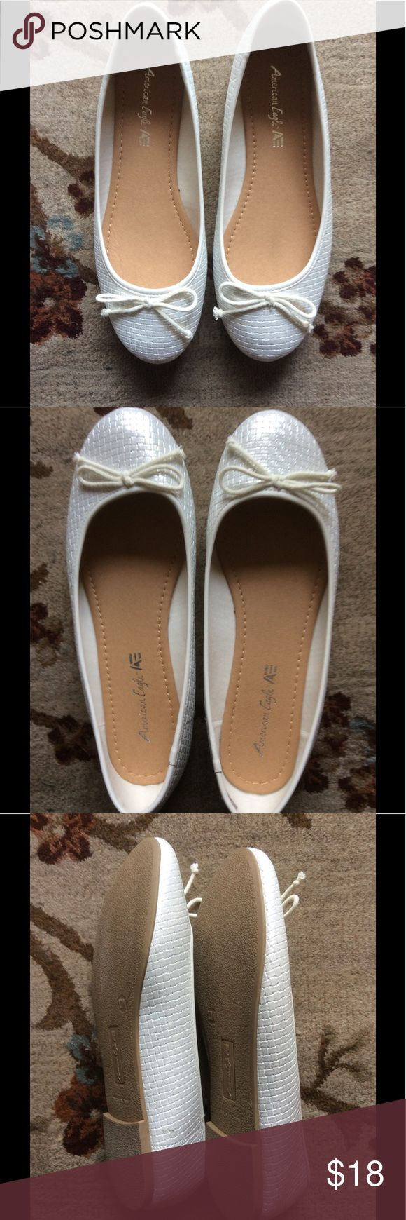American Eagle White Ballet Flats 10W These are a pair of cute American Eagle White Ballet Flats with a thin bow. Size 10W. About 4 inches wide in toe area. Used only once! Pair them with a cute skirt or pants. American Eagle by Payless Shoes Flats & Loafers