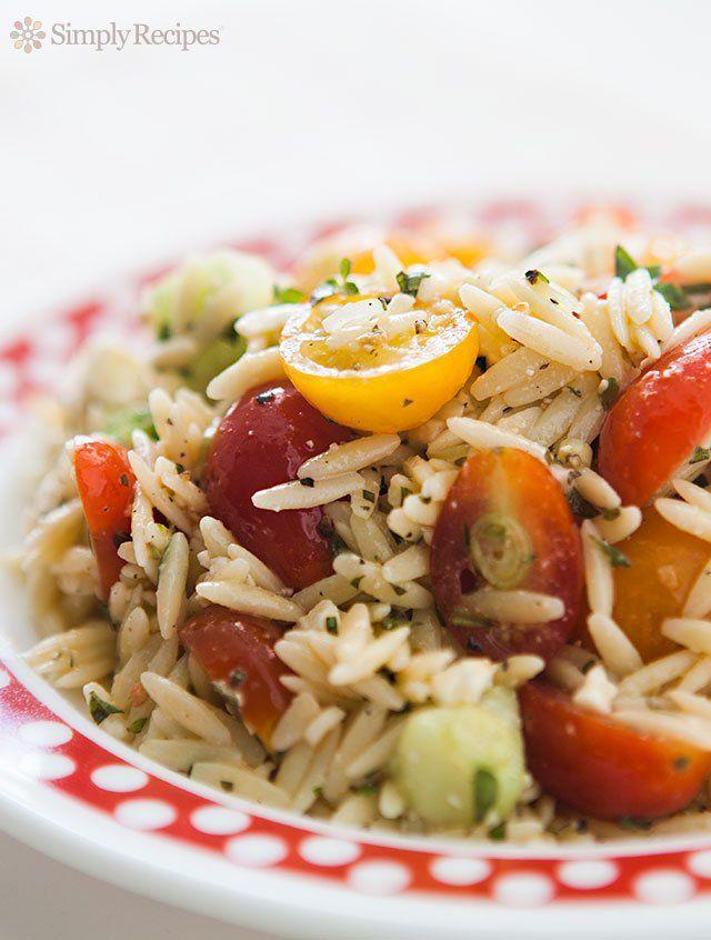 salad of cherry tomatoes, orzo pasta, cucumbers, feta cheese, oregano ...
