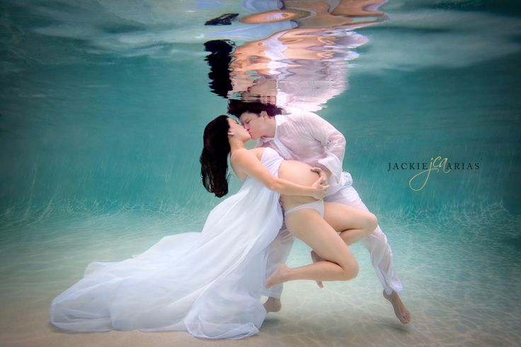 A Kiss...JCA Photography - Underwater maternity couples photo shoot, shot in Miami Fl. in a pool.