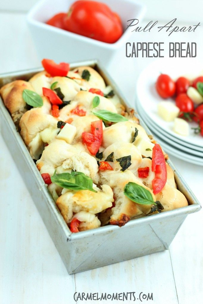 Pull Apart Caprese Bread - Delicious homemade dough topped with fresh tomatoes, basil and mozzarella. This bread makes the perfect summer appetizer! @carmelmoments