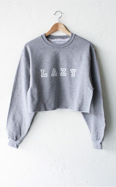 - Description - Size Guide Details: Soft & cozy oversized cropped sweater in grey with print featuring 'Lazy'. Oversized, Unisex fit. Brand: NYCT Clothing. 50% Cotton, 50% Polyester. Imported. Sizing: