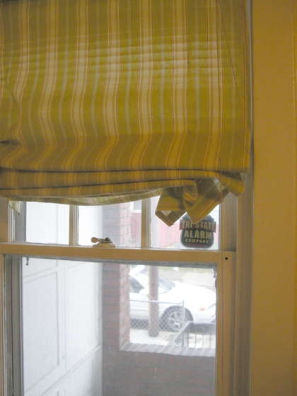 "Make a roman shade out of an old blind. Line a piece of fabric 1"" wider than your blind and 3"" longer. Attach to top of blind and bottom with hot glue or velcro. Attach fabric every 7"" to blind string and wala, you have a new blind."