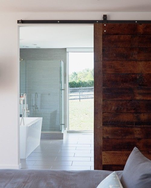 Industrial Sliding Door And Bathroom With A View