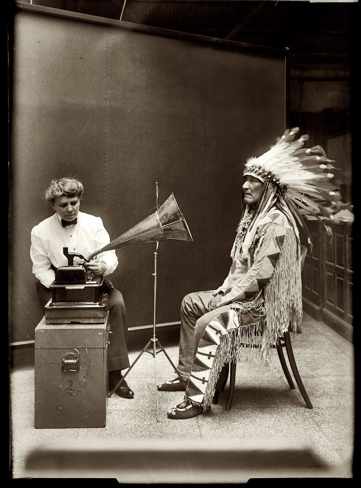 "February 9, 1916. ""Mountain Chief of Piegan Blackfeet making phonographic record at Smithsonian."" The interviewer is ethnologist Frances Densmore. National Photo Company Collection glass negative."