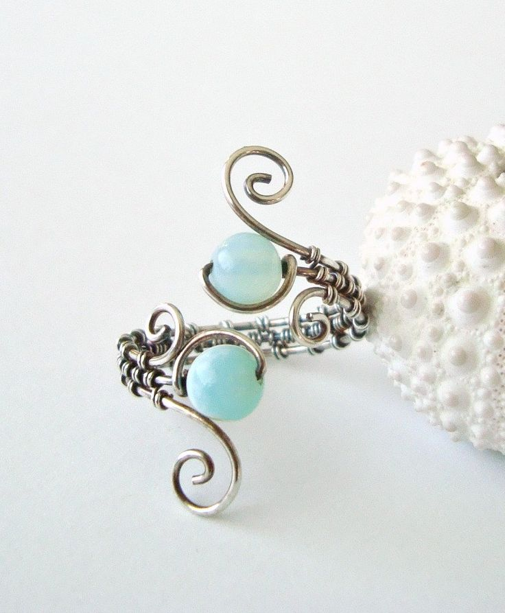 Peruvian Opal Wire Ring, Aqua Wire Wrapped Ring, Adjustable, Oxidized Sterling Silver Wire Weave Ring. $43.00, via Etsy.