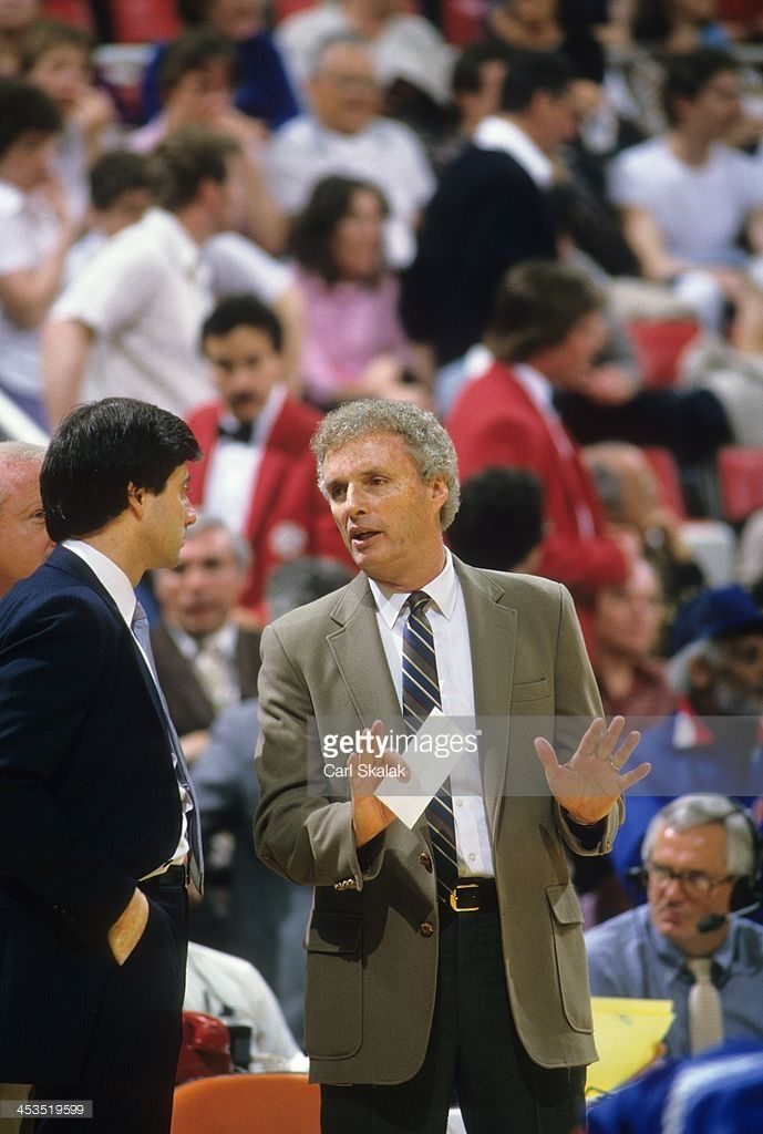 New York Knicks head coach Hubie Brown talking to assistant coach Rick Pitino on sidelines during Game 5 vs Detroit Pistons at Pontiac Silverdome. Carl Skalak F4 )