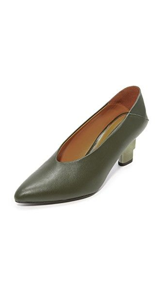Get this JAGGAR's heeled shoe now! Click for more details. Worldwide shipping. JAGGAR V Cut Convertible Pumps: A tiered metallic heel lends unique edge to these leather JAGGAR pumps. A fold-down heel converts the pair to mules. Rubber soles. Leather: Goatskin. Imported, China. This item cannot be gift-boxed. Measurements Heel: 2.5in / 65mm (zapato de tacón, tacones, tacon, tacon alto, tacón alto, heel, heels, schuhe mit absatz, zapato de tacón, chaussure à talon, scarpe con i tacchi, tac�...