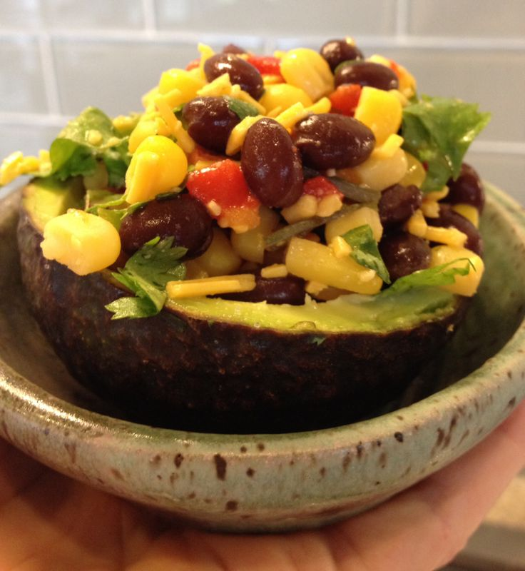 Tex Mex Stuffed Avocado:   Rinsed black beans, steamed crisp corn, pimentos, shredded cheese, onion and garlic powder, splash of Worcestershire, splash of banana pepper juice, lime juice and pinch of cumin and sea salt.  Adjust spices to your taste. (Enjoying from a piece of pottery I made)