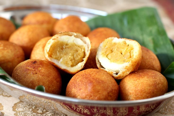 Traditional Indian sweet - Pala Munjalu. Special Andhra delicacy has a filling of sweetened bengal gram flavored with caradamom that is enclosed in rice flour dough that has been cooked in milk and deep fried to a golden shade.
