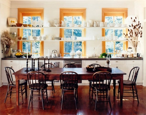Almost perfect kitchen:  open shelves in front of window; mix of white cabinets with natural wood trim on windows and doors; large table instead of ubiquitous island.  Would only change chairs to something modern for contrast (lucite, for example)