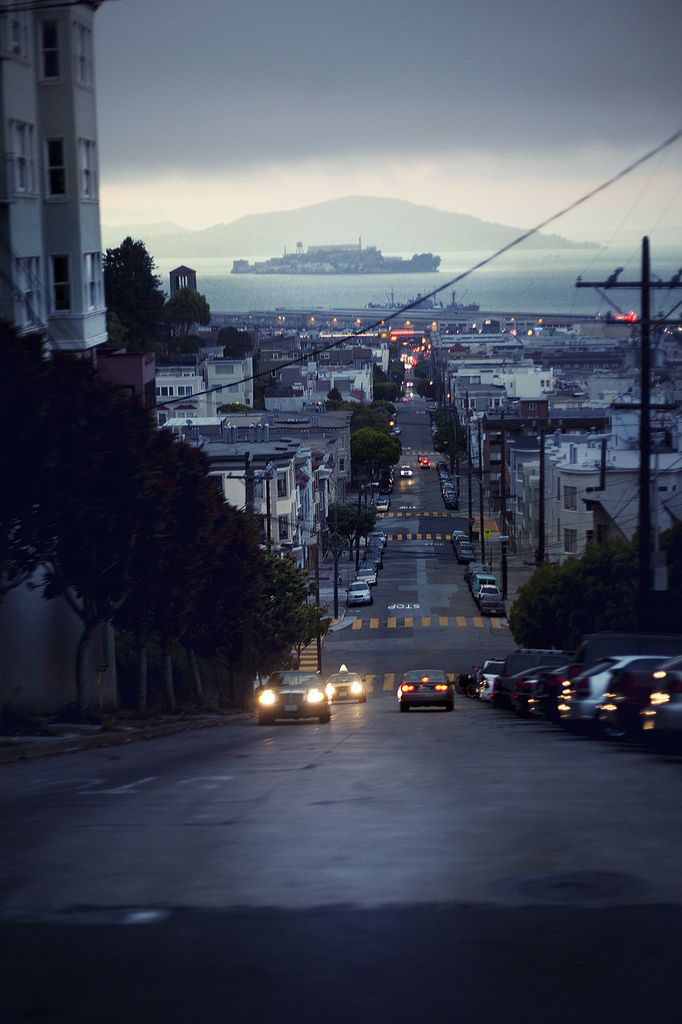 San Francisco - with Alcatraz at the horizon - Tags: city, skyline, houses, rooftops, hills, roads, cars, headlights, tail lights, traffic, ocean, water, overcast