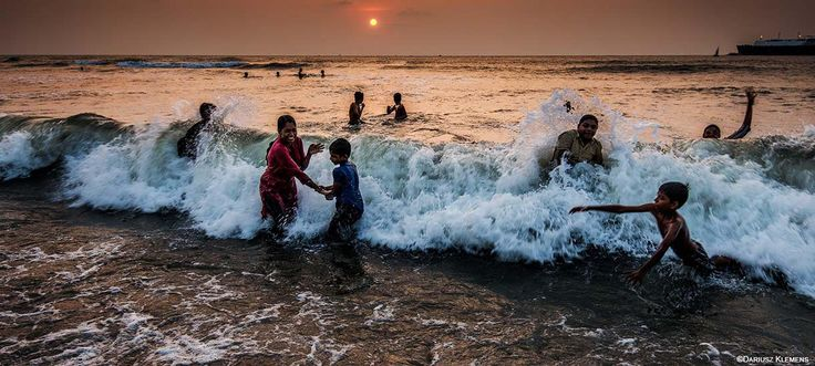 Children play in the waves of the Arabian Sea at sunset on Fort Kochi beach, in Kochi, Kerala, South India. Photo: © Dariusz Klemens