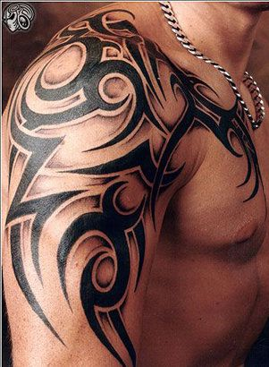 Chest Shoulder Tribal Tattoo Design....should Cam ever decide on a tattoo, this is cool