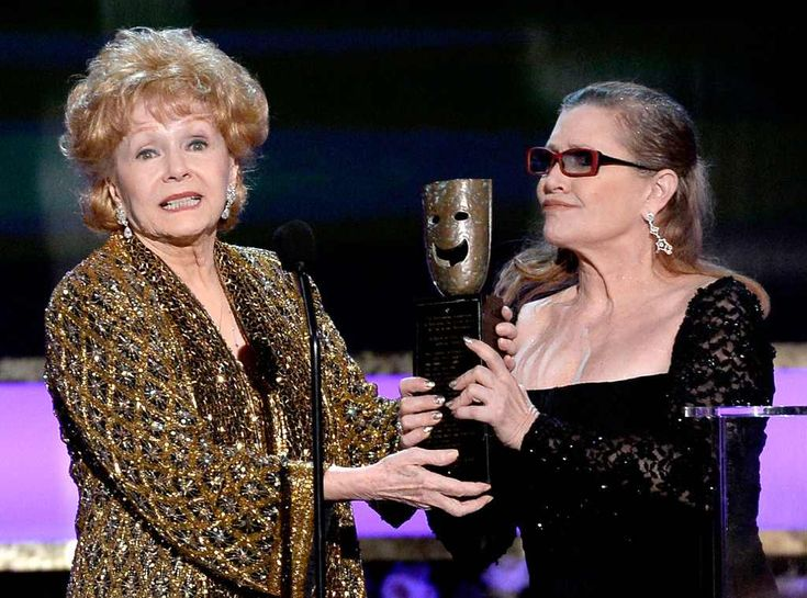Major Honor from Debbie Reynolds & Carrie Fisher's Mother-Daughter Moments  Carrie presents Debbie with theSAG Life Achievement Award at the 2015Screen Actors Guild Awards.