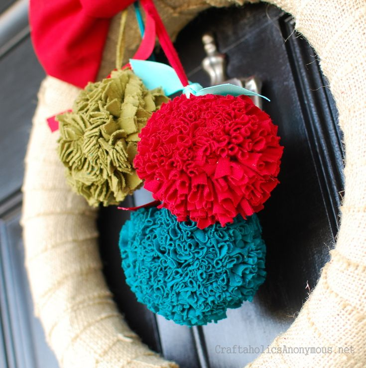 Pom Pom tutorial:  http://www.craftaholicsanonymous.net/2011/12/how-to-make-fabric-pom-pom-christmas-wreath.html