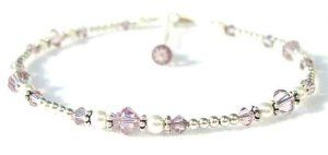 Damali - Purple Crown (Sahasrara) Chakra Anklet for inner wisdom, meditation, motivation, spirituality, unity - MEDIUM 9.5 In. Damali. $49.95. Adjustable 1 Inch chain extenstion included. .925 Sterling Silver. Genuine Swarovski Austrian Crystals. Secure lobster clasp closure. Genuine freshwater pearls
