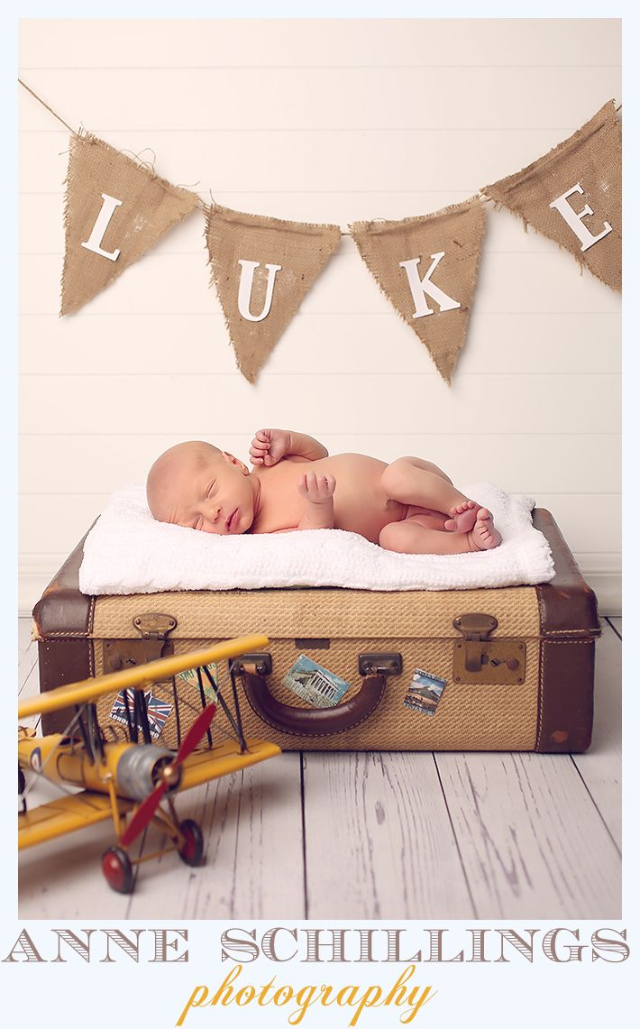 Anne Schillings Photography  newborn portraits  https://www.facebook.com/anneschillingsphotography  newborn boy brother siblings family  pink blue studio blanket white sleep sleepy face cute child portrait vintage airplane banner Luke suitcase stickers travel flight biplane wood