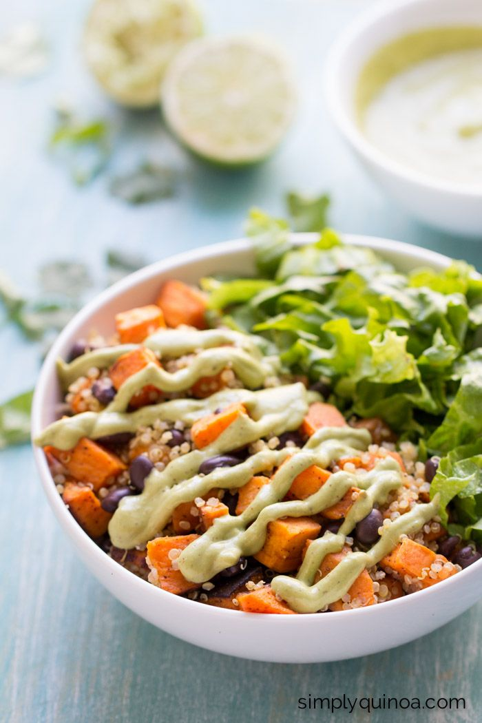 Chili roasted sweet potatoes are tossed into this black bean quinoa salad with is served with a creamy (vegan) cilantro-avocado dressing.
