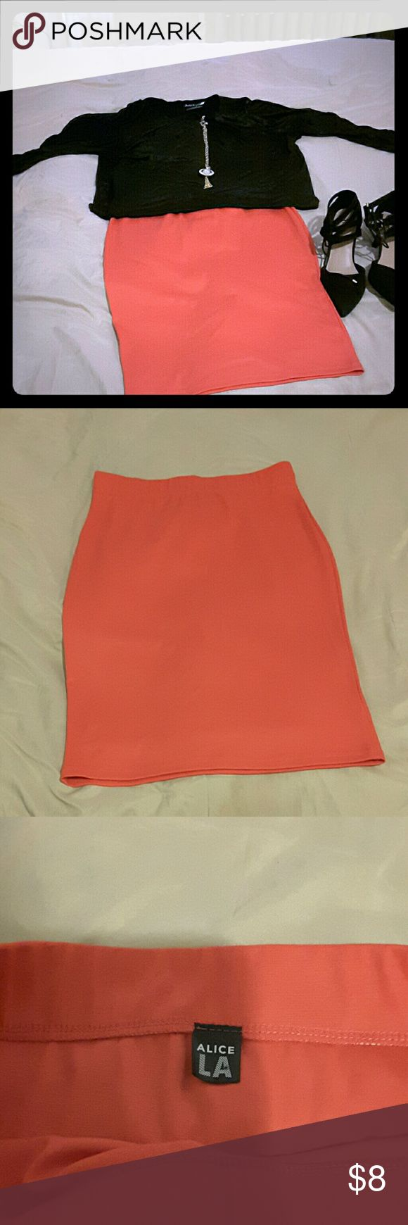 Coral pencil  skirt Cute Coral pencil skirt  sits right in the middle of my knees. And I am 5'6. Has an elastic waste band Stretchy material Skirts Pencil