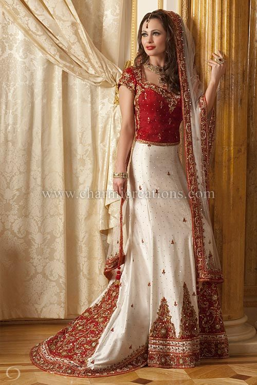 Indian Bridal Dresses - White raw silk classic bridal lengha with a rusty red blouse and a short train with embroidered patch work