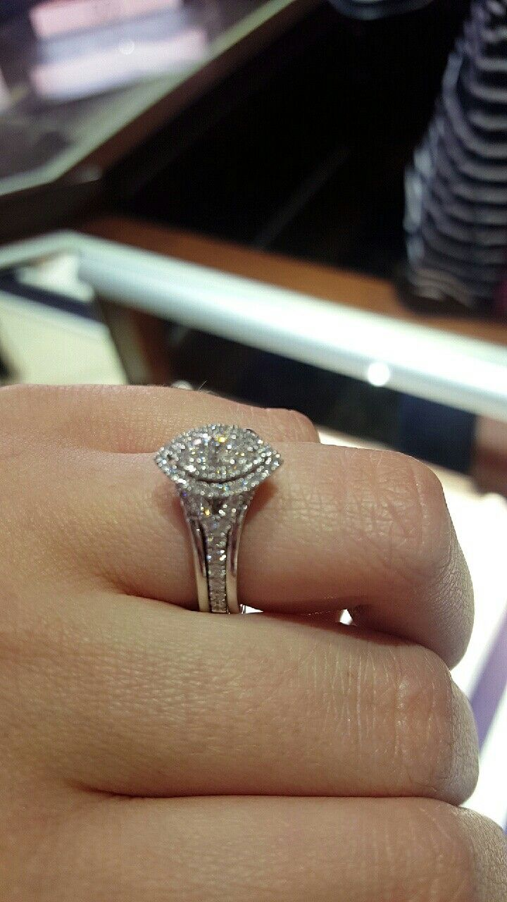 Stunning marquis cut engagement with double halo. Split shank band for simplicity and beauty.