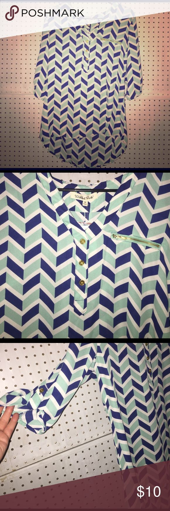 BRAND NEW Chevron shirt 3/4 sleeve w fake buttons This is a blouse by Wishful Park. It is mint green, Royal blue, and white chevron. It has 3 fake gold buttons coming down, one on each sleeve, and a fake gold zipper on the breast. Shorter in the front, longer in the back. Wishful Park Tops Blouses