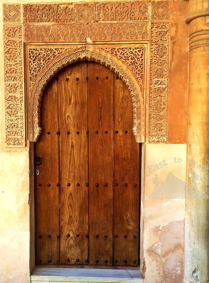 A wooden door in the Nasrid Palace.  #wooden #engraving #beautiful #arabic #arabicscript #arabicwriting #nasridpalace #door #stonework #easttowestadventures #alhambra #spain #andalucia  #مغامرات #غرناطة #قصرالحمراء #الاندلس #سفر #سافر #اسبانيا #اوروبا