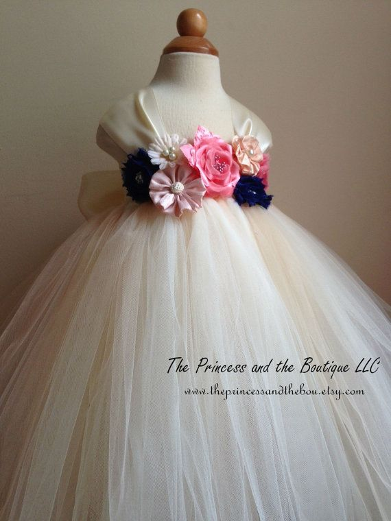 This tutu dress is made with ivory and champagne tulle and has a ivory crochet top, it is adorned with a cluster of ivory rosette, peach,