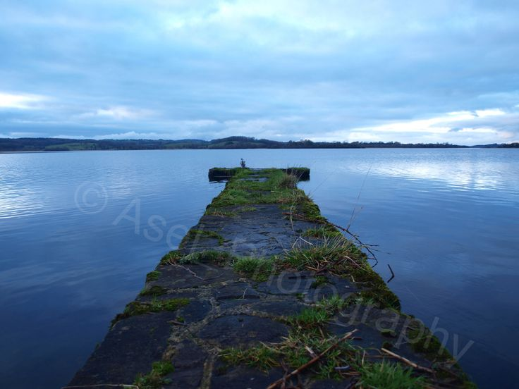 Pier at the lough. Evening photography.